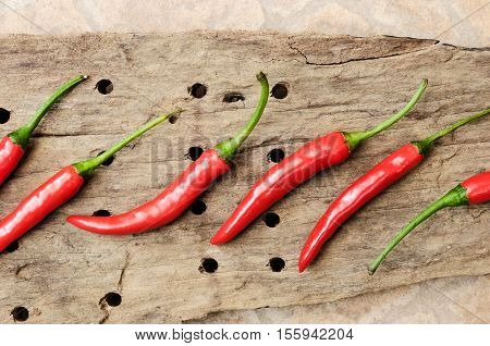 Multitude Of Red Chili Peppers On Wooden Table, Closeup View