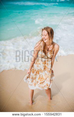 The Girl Walks On The Water's Edge On The Boracay