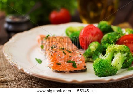 Baked Fish Salmon Garnished With Broccoli And Tomato. Dietary Menu. Fish Menu. Seafood - Salmon.