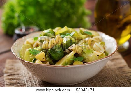 Stewed Brussels Cabbage Sprouts, Apples And Leeks In Bowl. Dietary Menu.