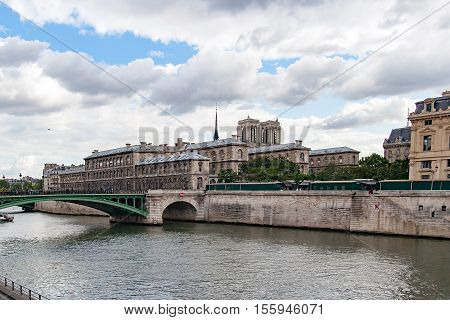 PARIS, FRANCE CIRCA APR 2016. Partial view of Notre Dame bridge, To the right the conciergerie and towers of the cathedral of Notre Dame de Paris. View from the river Seine