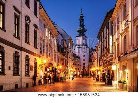 17. february 2015 - Bratislava Slovakia: evening illumination of old street in historic center of Bratislava with famous tower called