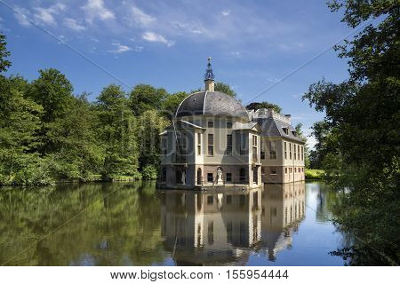 Manor house Trompenburg reflecting in its pond is an important estate near the Dutch village 's-Graveland