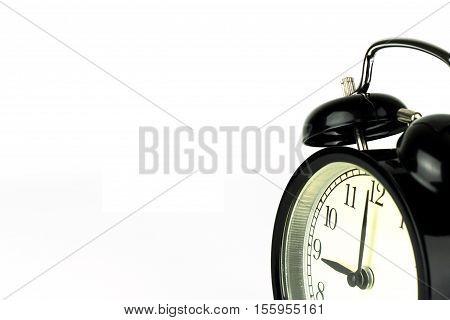 Alarm Clock on white showing nine o'clock.