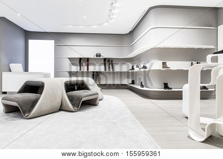 fashionable interior of shoe store in modern mall