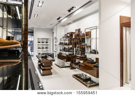 fashionable interior of cloth store in modern mall