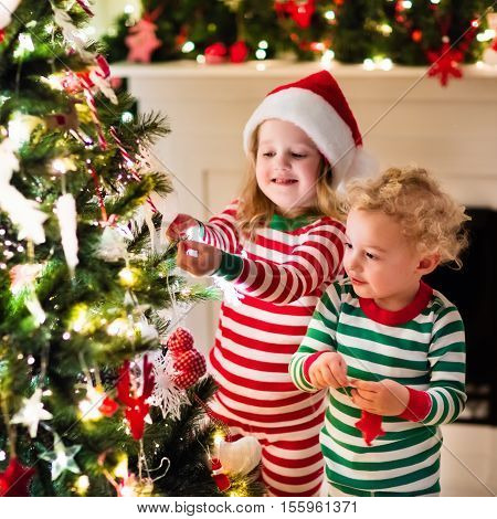 Kids In Pajamas Under Christmas Tree