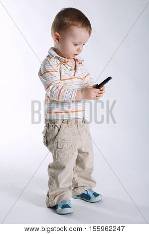 photo of little boy with mobile phone