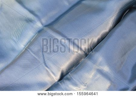 Silver satin background. Texture of a fabric