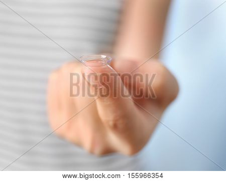 Female hand with contact lens, close up view. Healthy eyes concept