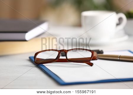 Close up view of glasses on clipboard. Healthy eyes concept