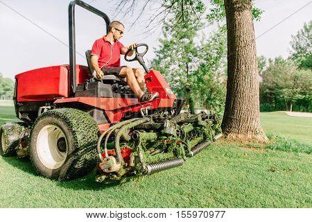 Golf course maintenance fairway mower, toned image