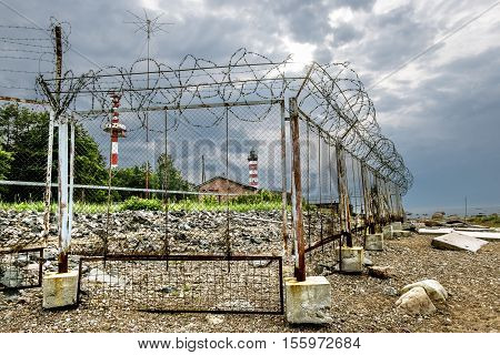 Shepelevsky Cape.Russia.26 Jun 2016.Fenced with barbed wire the territory Shepelevskii lighthouse on the Gulf of Finland in Leningrad region