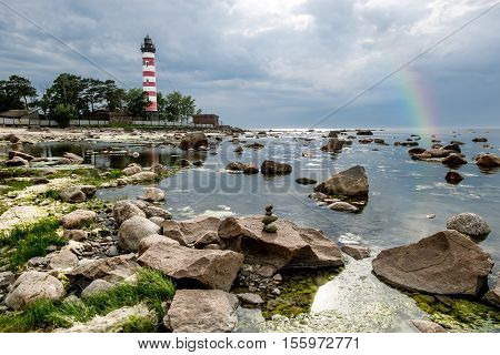 Shepelevsky Cape.Russia.26 Jun 2016.Shepelevsky lighthouse on the Gulf of Finland in the Leningrad region with a rainbow after the rain