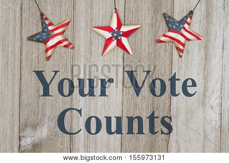 USA patriotic voting message USA patriotic old flag on a stars with weathered wood background with text Your Vote Counts