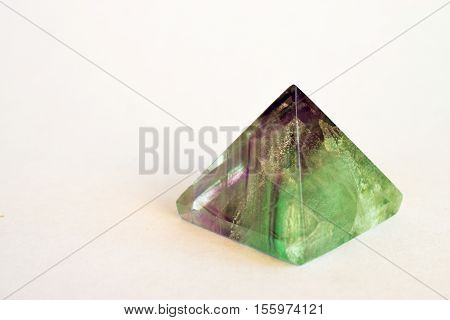 Green and Purple Fluorite Crystal Pyramid on White Background