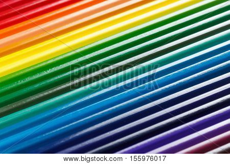Set of colored pencils for drawing closeup background