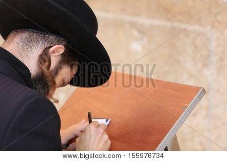 Jerusalem, Israel - November 2 , 2016: Orthodox Jewish Man at the Western Wall in Jerusalem, Judaism's holiest site