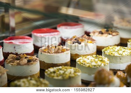 showcase with homemade cakes in a shop
