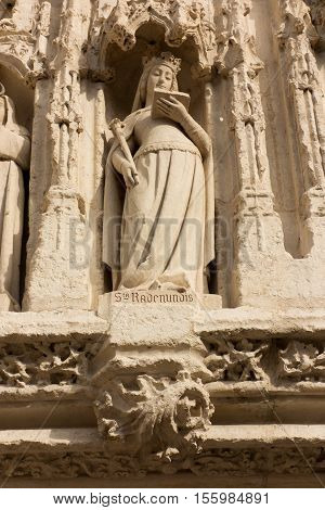Figure st. Rodegunda on the facade Church of Sts. Radegund at Poitiers in France