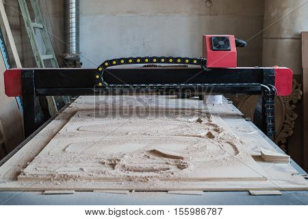 Automated cutting CNC machine in wood work shop.