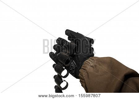 Isolated first person view soldier hand in black battle gloves & tactical jacket holding an empty ammo cartridge belt.