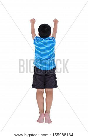 Top view of child look like flying superhero isolated on white background. Studio shot.
