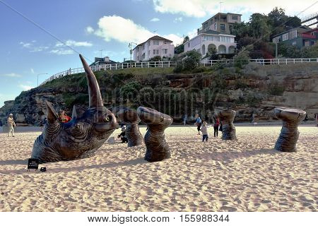 Sydney Australia - Oct 23 2016. Gillie and Marc Schattner: Buried Rhino. Sculpture by the Sea along the Bondi to Coogee coastal walk is the world's largest free to the public sculpture exhibitions.
