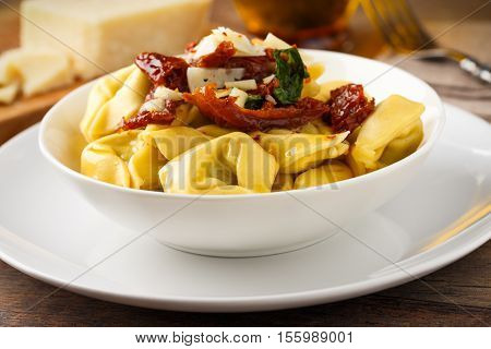 Tortelloni aglio olio e peperoncino with sundried tomatoes parmesan and basil.