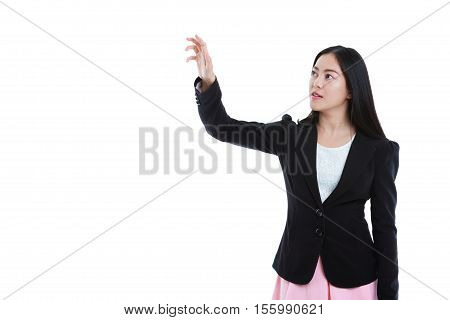Asian businesswomen pressing the touchscreen button with copy space. Pretty woman touching at something isolated presenting on white background.