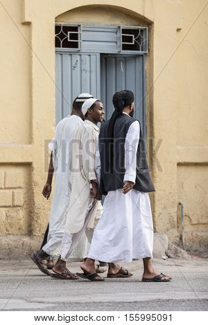 DIRE DAWA, ETHIOPIA-APRIL 16, 2015: Unidentified Somali men walk down the street of Dire Dawa, Ethiopia, near the Somali border