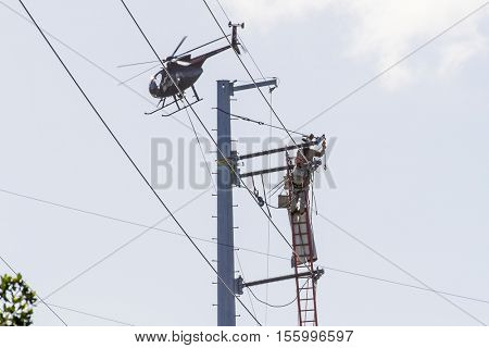 Key Largo, FL - Oct 17, 2016: Aerial crews work on repairs from Hurricane Matthew that hit the Florida Keys in early October.
