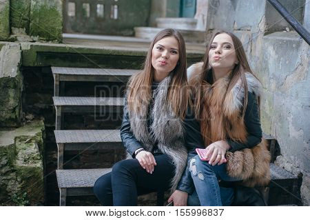 young model walk around town in fur coats