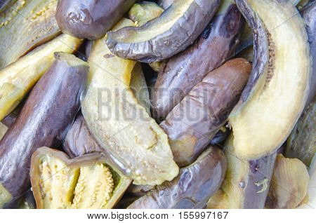 Chopped and soaked eggplant as a background.