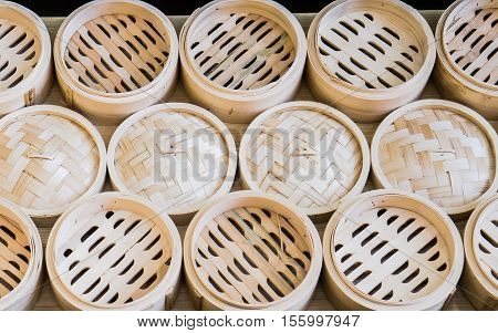 Dim Sum and Dumpling Basket made from bamboo decoration on the wall in Dim Sum restaurant, Bamboo basket for Dim Sum and Dumpling, Steamed secondary container for Dim Sum