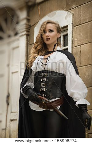 Sexy Woman In Pirate Style With Old Handgun