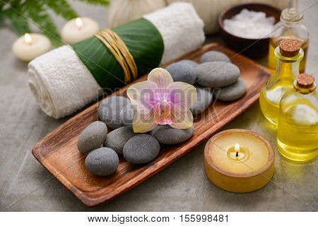Composition of bath spa treatment on gray background