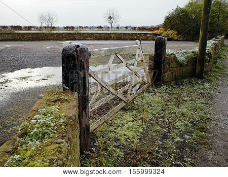 Old vintage wooden gate to the farm in Cheshire (UK) during frost