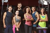 Group of sportive people in gym poster