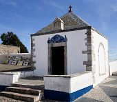 View of the Memoria Hermitage a 12th century old small chapel located on the hilltop O Sitio overlooking Nazare Portugal poster