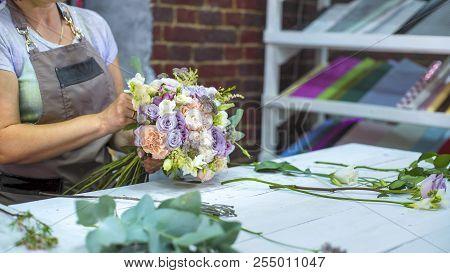 Professional Florist Arranging Wedding Bouquet In Design Studio With Free Copy Space. Caucasian Fema