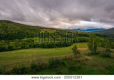 Beautiful Landscape In Mountains. Agricultural Fields On Hills. Gloomy And Overcast Weather In Autum