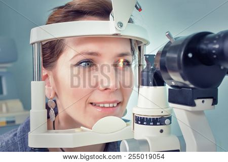 Checking Eyesight In A Clinic Of The Future, Young Girl. Ophthalmology. Future Medicine And Health C