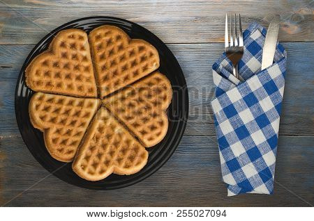 Belgian Waffles Wooden Background. Waffles On A Plate Top View