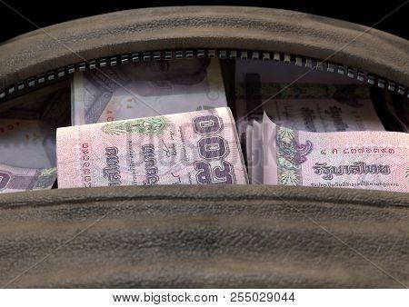 Illicit Cash In A Brown Duffel Bag