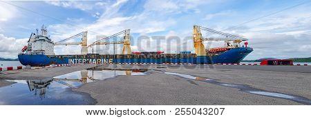 Chonburi, Thailand - May 24, 2018 : Blue And White Cargo Ship Leaves Port At Chuk Samet Deep Sea Por
