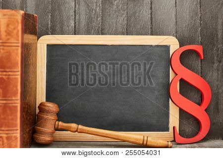 Chalkboard law gavel and paragraph as law concept