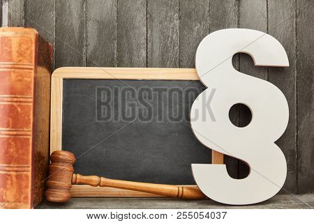 Blank blackboard and law and law concept by paragraph and judge gavel