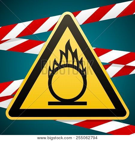 Caution Oxidizer. Safety Sign. Yellow Triangle With Black Image On The Background Of Protective Tape