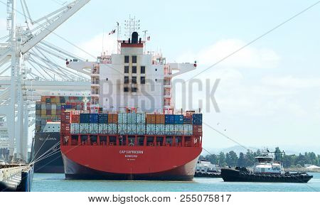 Oakland, Ca - May 17, 2018: Cargo Ships Are Unable To Maneuver Sideways.  Multiple Tugboats Assist C